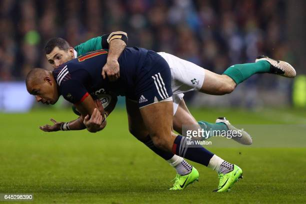 Gael Fickou of France is tackled by Rob Kearney of Ireland during the RBS Six Nations match between Ireland and France at the Aviva Stadium on...
