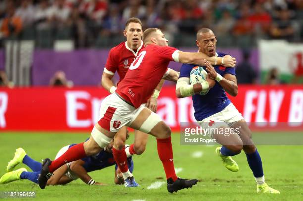 Gael Fickou of France is tackled high by Ross Moriarty of Wales which leads to Ross Moriarty receiving a yellow card during the Rugby World Cup 2019...