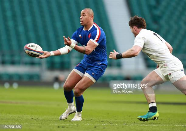 Gael Fickou of France passes the ball during the Guinness Six Nations match between England and France at Twickenham Stadium on March 13, 2021 in...