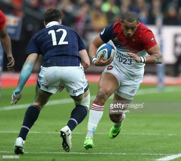 Gael Fickou of France takes on Alex Dunbar during the RBS Six Nations match between France and Scotland at Stade de France on February 12, 2017 in...