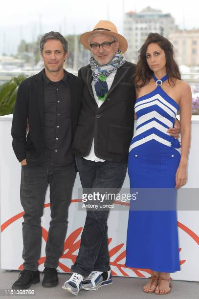 Gael García Bernal Director Elia Suleiman and Yasmine Hamdan attend thephotocall for It Must Be Heaven during the 72nd annual Cannes Film Festival...