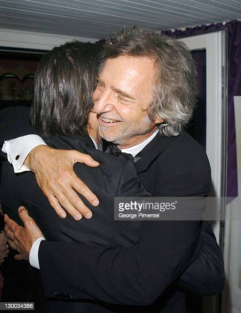 Gael Garcia Bernal and Curtis Hanson during 2004 Cannes Film Festival Motorcycle Diaries Party at La Plage Coste in Cannes France