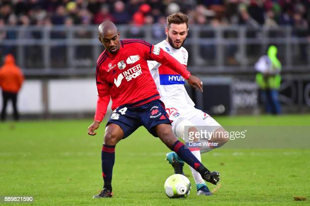 Gael Kakuta of Amiens and Lucas Tousart of Lyon during the Ligue 1 match between Amiens SC and Olympique Lyonnais at Stade de la Licorne on December...