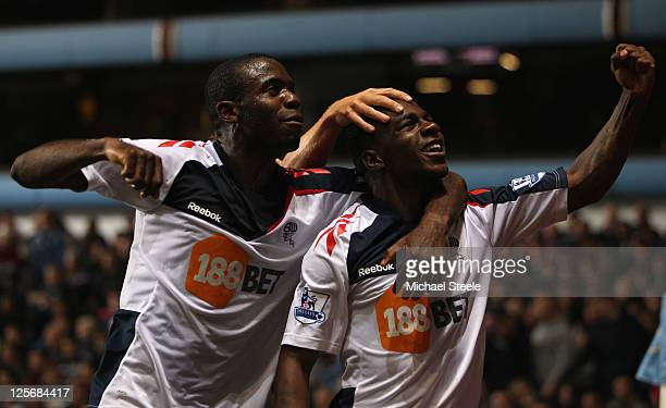 Gael Kakuta of Bolton Wanderers celebrates scoring his sides second goal with Fabrice Muamba during the Carling Cup third round match between Aston...