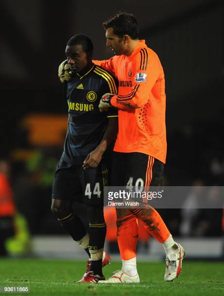 Gael Kakuta of Chelsea is consoled by team mate Henrique Hilario after his penalty was saved to clinch victory for Blackburn in a penalty shootout...