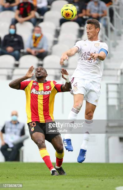 Gael Kakuta of Lens, Laurent Koscielny of Bordeaux in action during the Ligue 1 match between RC Lens and Girondins de Bordeaux at Stade...