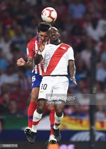 Gael Kakuta of Rayo Vallecano de Madrid is challenged by Stefan Savic of Club Atletico de Madrid during the La Liga match between Club Atletico de...