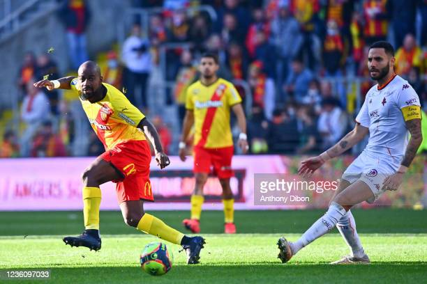 Gael KAKUTA of Rc Lens and Dylan BRONN of Metz during the Ligue 1 Uber Eats match between Lens and Metz at Stade Bollaert-Delelis on October 24, 2021...