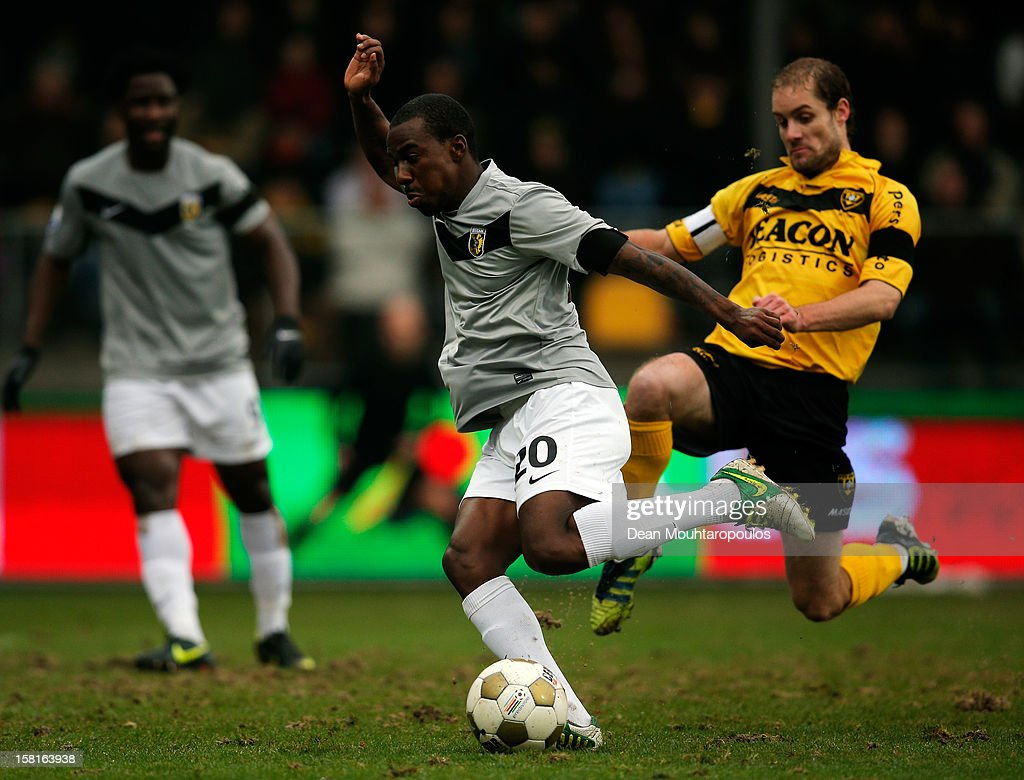 Gael Kakuta (#20) of Vitesse in action as defender Marcel Seip of Venlo attempts the tackle during the Eredivisie match between VVV Venlo and Vitesse Arnhem at the Seacon Stadion De Koel on December 9, 2012 in Venlo, Netherlands.