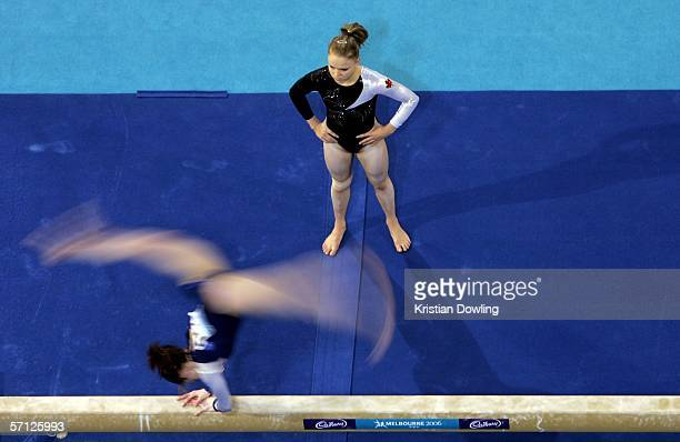 Gael Mackie of Canada watches a fellow athlete warmup prior to the Women's Individual AllRound Final in the Artistic Gymnastics at the Rod Laver...