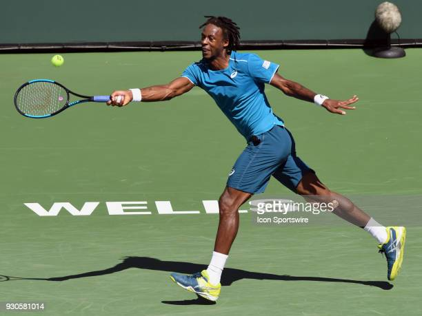 Gael Monfils chases down the ball and returns a shot during the first set of a match played during the BNP Paribas Open played on March 11 2018 at...