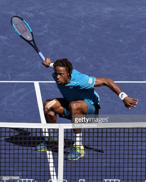 Gael Monfils lands on the court after leaping in the air and hitting a shot for a winner in the first set of a match played during the BNP Paribas...