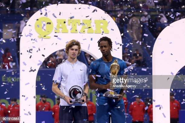 Gael Monfils of France and Andrey Rublev of Russia pose with their awards after their Qatar ExxonMobil Open 2018 Tennis Tournament Men's Final match...