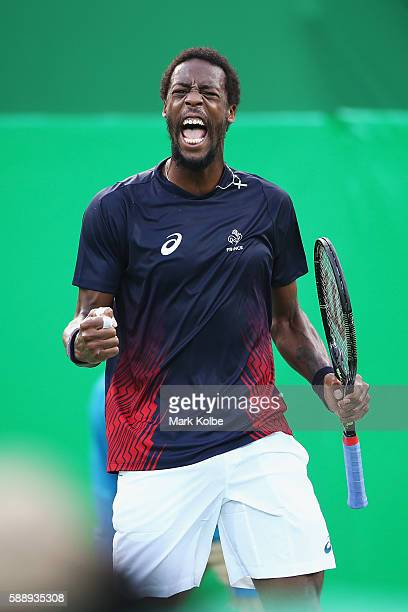 Gael Monfils of France celebrates a point against Kei Nishikori of Japan in the Men's Singles Quarterfinal on Day 7 of the Rio 2016 Olympic Games at...