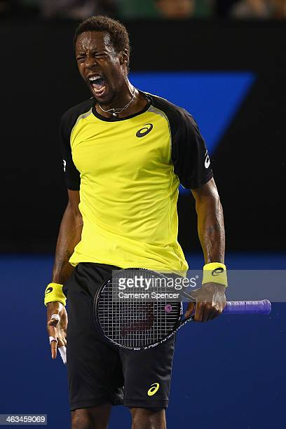 Gael Monfils of France celebrates a point during his third round match against Rafael Nadal of Spain during day six of the 2014 Australian Open at...