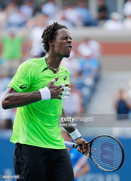 Gael Monfils of France celebrates after defeating Grigor Dimitrov of Bulgaria in their men's singles fourth round match on Day Nine of the 2014 US...