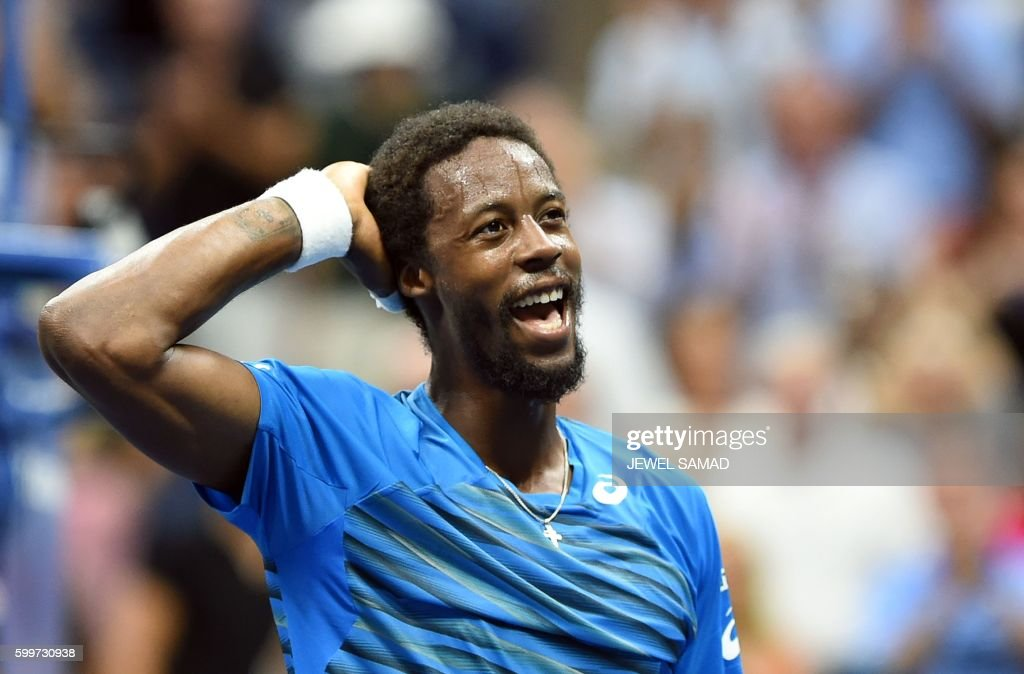TOPSHOT - Gael Monfils of France celebrates after defeating his compatriot Lucas Pouille during their 2016 US Open Mens Singles quarterfinal match at the USTA Billie Jean King National Tennis Center in New York on September 6, 2016. / AFP PHOTO / Jewel SAMAD