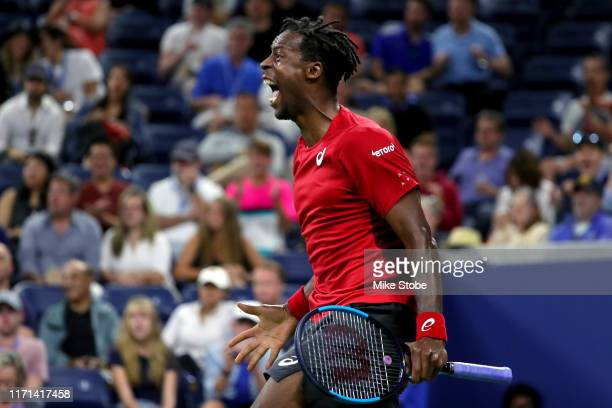 Gael Monfils of France celebrates after winning a game during his Men's Singles third round match against Denis Shapovalov of Canada on day six of...