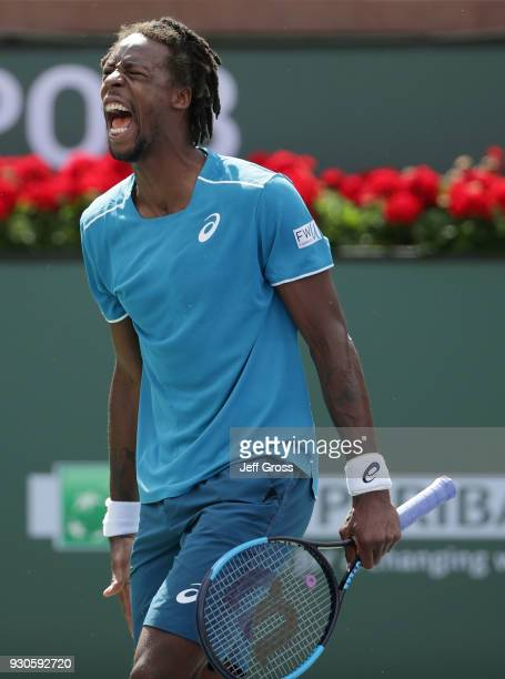 Gael Monfils of France celebrates after winning a point against John Isner during the BNP Paribas Open on March 11 2018 at the Indian Wells Tennis...