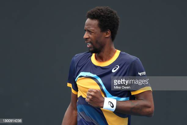 Gael Monfils of France celebrates after winning a point in his Men's Singles first round match against Emil Ruusuvuori of Finland during day one of...