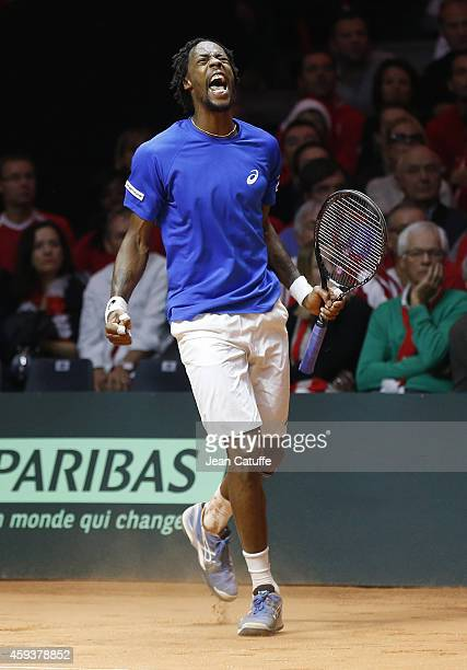 Gael Monfils of France celebrates defeating Roger Federer of Switzerland during day one of the Davis Cup tennis final between France and Switzerland...