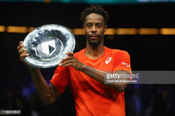 Gael Monfils of France celebrates his victory against Stan Wawrinka of Switzerland with the trophy after their Mens Final during Day 7 of the ABN...