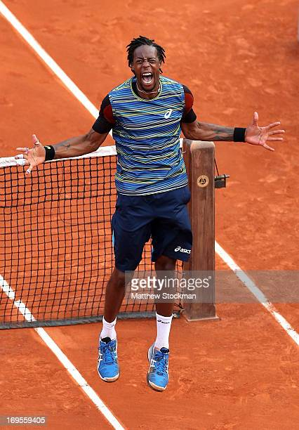 Gael Monfils of France celebrates match point in his Men's Singles match against Tomas Berdych of Czech Republic during day two of the French Open at...