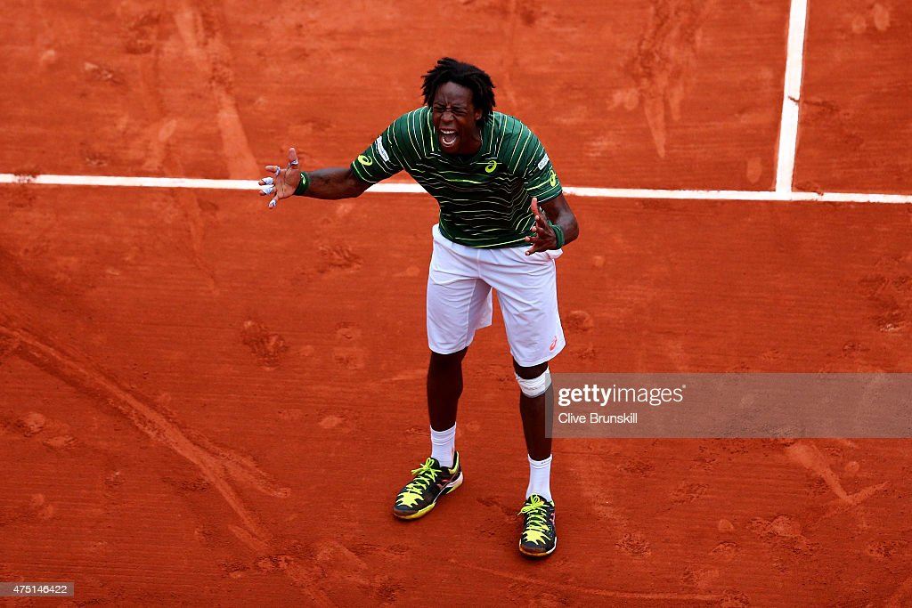 Gael Monfils of France celebrates match point in his Men's Singles match against Pablo Cuevas of Uruguay on day six of the 2015 French Open at Roland Garros on May 29, 2015 in Paris, France.