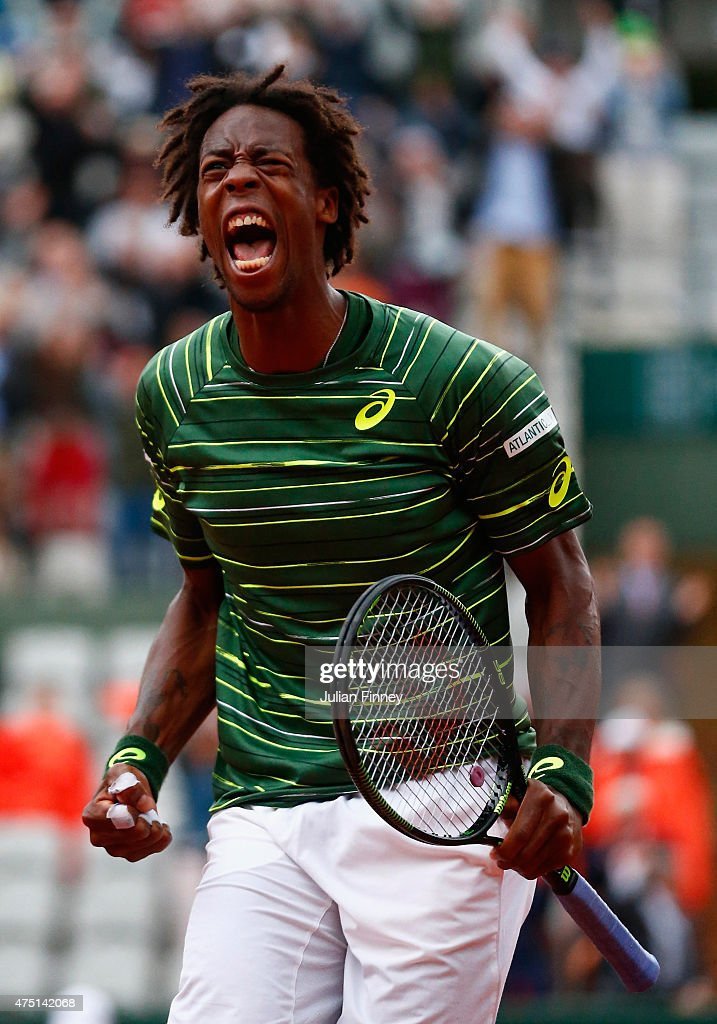 Gael Monfils of France celebrates the fourth set point in his Men's Singles match against Pablo Cuevas of Uruguay on day six of the 2015 French Open at Roland Garros on May 29, 2015 in Paris, France.