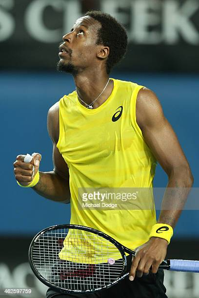 Gael Monfils of France celebrates winning his first round match against Ryan Harrison of the United States during day two of the 2014 Australian Open...
