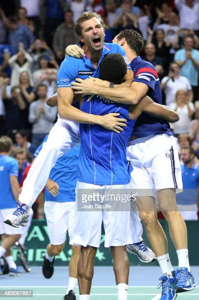 Gael Monfils of France celebrates with Julien Benneteau and Michael Llodra the qualification of Team France after beating Peter Gojowczyk of Germany...