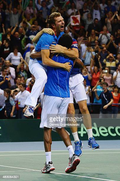 Gael Monfils of France celebrates with team mates after winning his match against Peter Gojowczyk of Germany during day 3 of the Davis Cup Quarter...