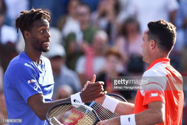 Gael Monfils of France demonstrates sportsmanship towards Roberto Bautista Agut of Spain during day 9 of the Rogers Cup at IGA Stadium on August 10...