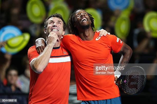 Gael Monfils of France embraces Pat Cash of Australia during the FAST4 Tennis exhibition match between Gael Monfils and Nick Kyrgios at Allphones...