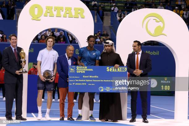Gael Monfils of France gets his award handed by Nasser AlKhelaifi President of the Qatar Tennis Federation and Chairman and chief executive officer...