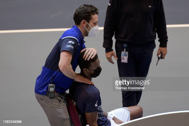 Gael Monfils of France gets medical treatment during his match against Pablo Carreno Busta of Spain during day three of the Erste Bank Open tennis...