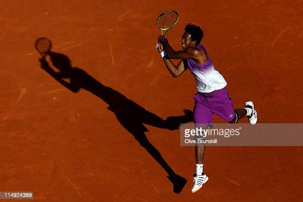 Gael Monfils of France hits a backhand during the men's singles round four match between David Ferrer of Spain and Gael Monfils of France on day...