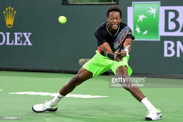 Gael Monfils of France hits a backhand return to Alexander Zverev of Germany during their Round of 16 match at the ATP-WTA Indian Wells tennis...
