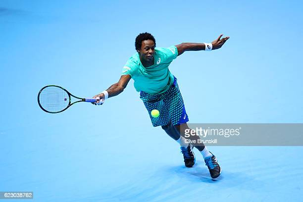 Gael Monfils of France hits a forehand during his men's singles match against Milos Raonic of Canada on day one of the ATP World Tour Finals at O2...