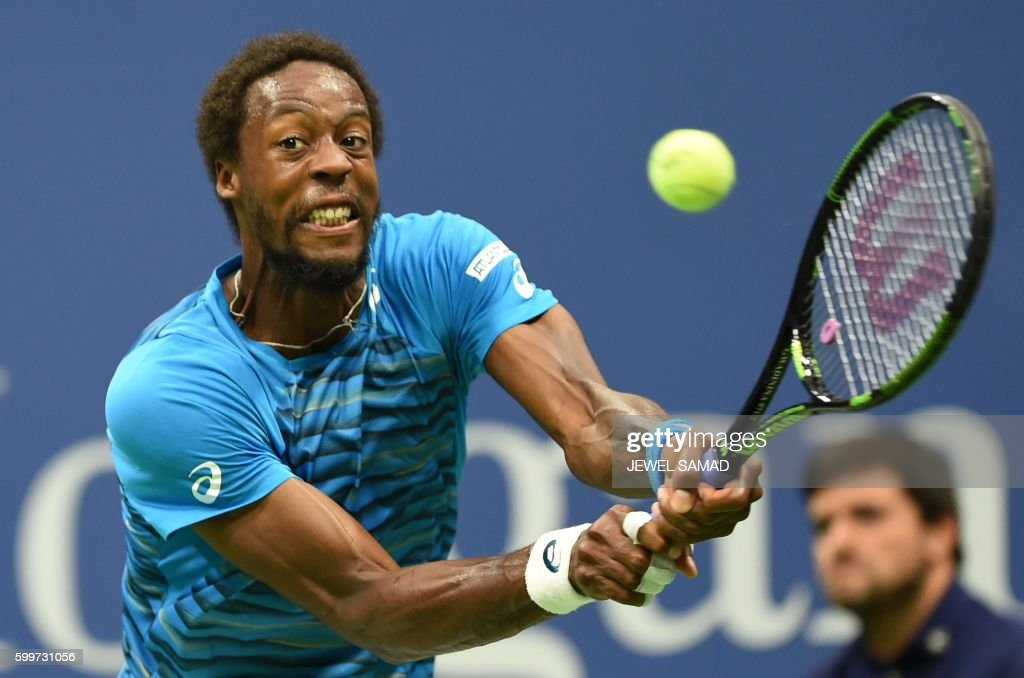 TOPSHOT - Gael Monfils of France hits a return against his compatriot Lucas Pouille during their 2016 US Open Mens Singles quarterfinal match at the USTA Billie Jean King National Tennis Center in New York on September 6, 2016. / AFP PHOTO / Jewel SAMAD