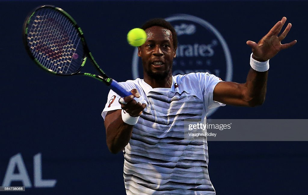 Gael Monfils of France hits a shot against Novak Djokovic of Serbia during Day 6 of the Rogers Cup at the Aviva Centre on July 30, 2016 in Toronto, Ontario, Canada. (Photo by Vaughn Ridley/Getty Images