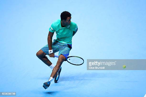 Gael Monfils of France hits a shot through his legs during his men's singles match against Milos Raonic of Canada on day one of the ATP World Tour...