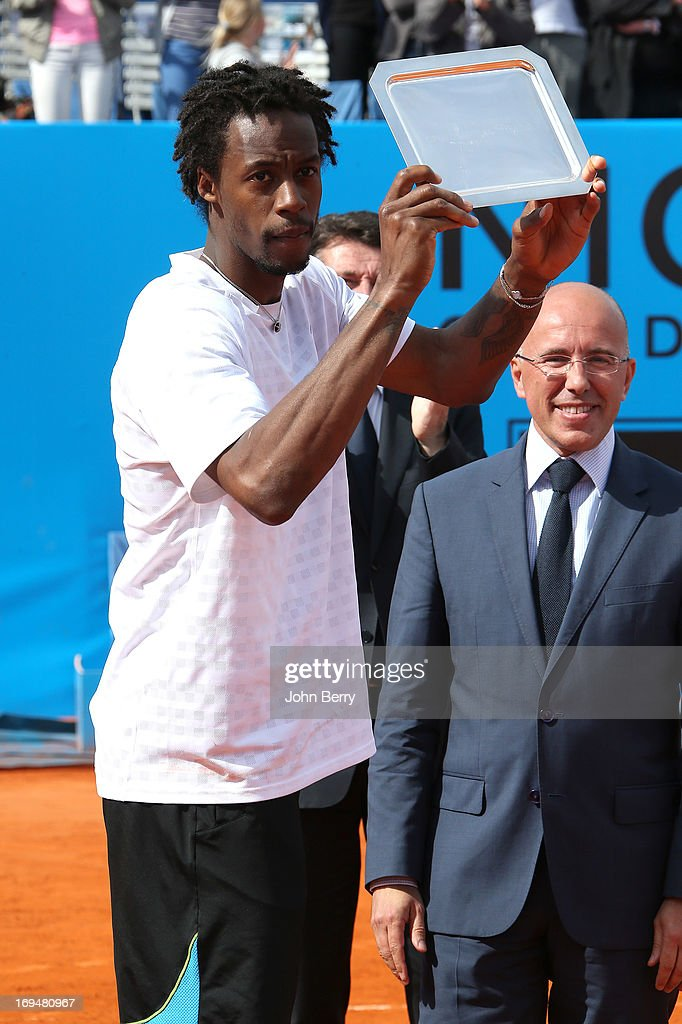 Gael Monfils of France holds the finalist trophy after losing against Albert Montanes of Spain during their final match during day seven of the Open de Nice Cote d'Azur 2013 at the Nice Lawn Tennis Club on May 25, 2013 in Nice, France.