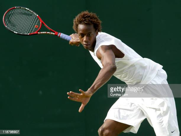 Gael Monfils, of France, in action, defeating Kristof Vliegen of Belgium, 7-5, 7-6, 7-6 int the second round of the Wimbledon Championships in...