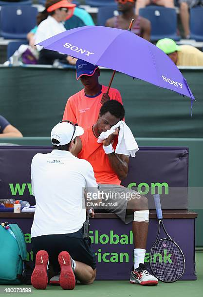 Gael Monfils of France is treated by the physio for an injury against Guillermo GarciaLopez of Spain during their second round match during day 6 at...