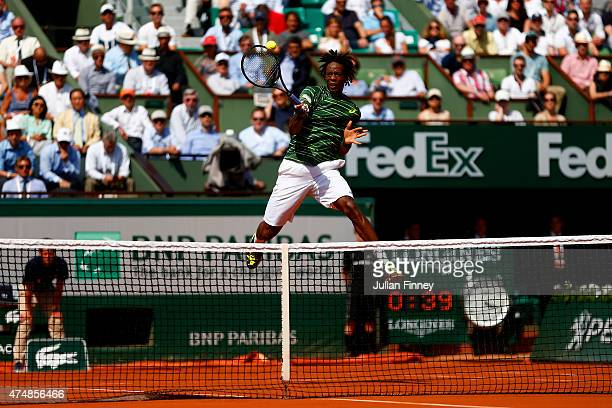 Gael Monfils of France jumps to hit a shot during the men's singles match against Diego Schwartzman of Argentina during day four of the 2015 French...