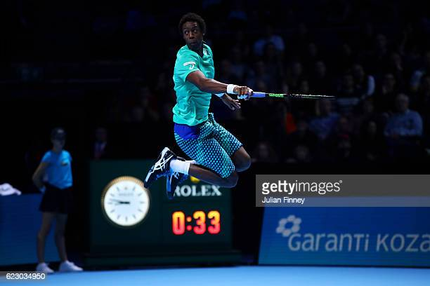 Gael Monfils of France leaps in the air during his men's singles match against Milos Raonic of Canada on day one of the ATP World Tour Finals at O2...