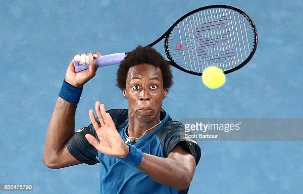 Gael Monfils of France leaps in the air to play a smash shot in his fourth round match against Rafael Nadal of Spain on day eight of the 2017...