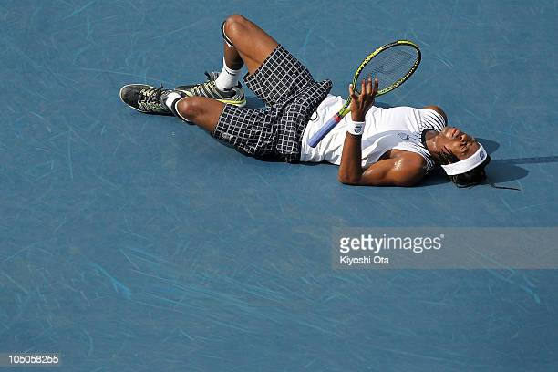 Gael Monfils of France lies on the court in his match against Andy Roddick of the United States on day five of the Rakuten Open tennis tournament at...