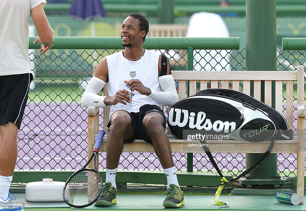 Gael Monfils of France looks on during a practice session with Michal Przysiezny of Poland during Day One of the Qatar Open 2013, first tournament of the ATP World Tour 2013, held at the Khalifa International Tennis and Squash Complex on December 31, 2012 in Doha, Qatar.